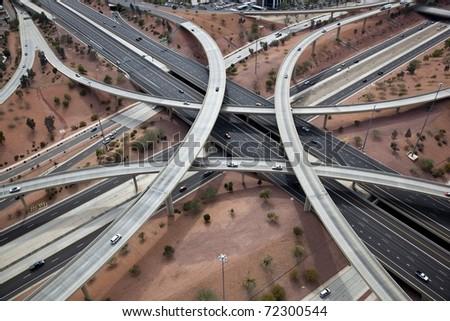 Aerial of metropolitan freeway interchange - stock photo