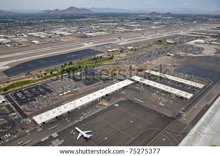 Aerial of plane loading cargo at an International Airport - stock photo