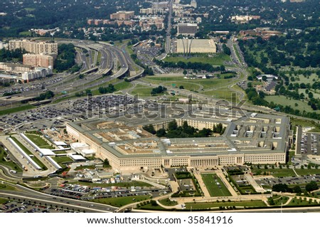 Aerial of the Pentagon, the Department of Defense headquarters in Arlington, Virginia, near Washington DC, with I-395 freeway on the left, and the Air Force Memorial up middle. - stock photo