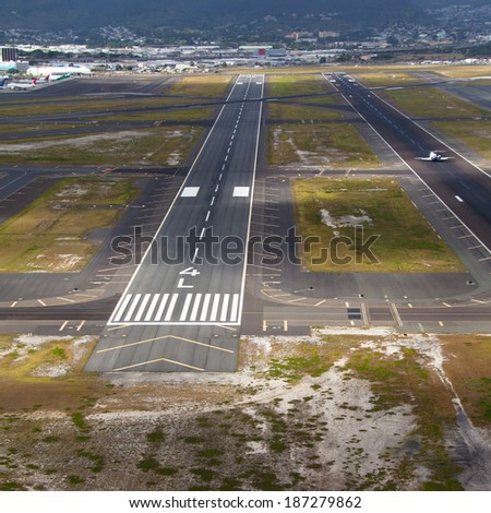Aerial overview of beautiful island runway - stock photo