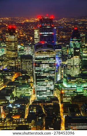 Aerial overview of the City of London financial ddistrict at night