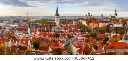 Aerial panorama of Old town with Town hall and Toompea hill, view from the tower of St. Olaf church, Tallinn, Estonia - stock photo