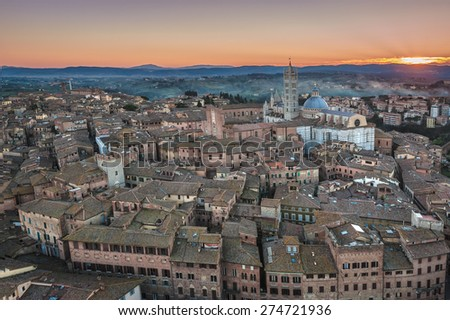 aerial panorama of the Tuscan medieval town of Siena, Italy - stock photo