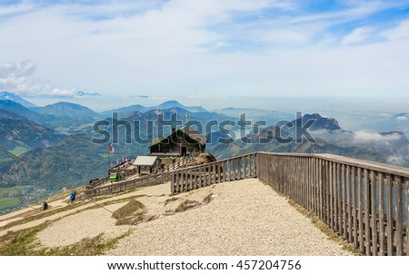 Aerial panoramic view from Schafberg mountain peak to the traditional wooden austrian house, cafe and Mondsee lake in the Salzburg province St. Wolfgang, Salzkammergut, Austria