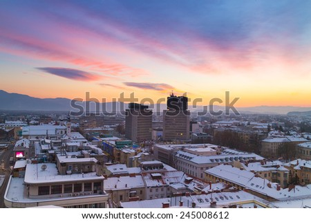 Aerial panoramic view of Ljubljana. Roofs covered in snow in winter time. Slovenia, Europe. - stock photo