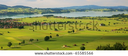 Aerial panoramic view on green fields and meadows of Germany. - stock photo