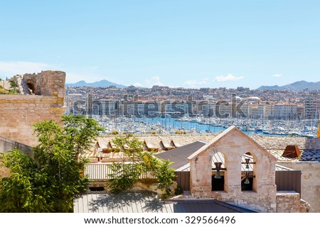 Aerial panoramic view on old port in Marseille, France. On sunny warm day in Provence. - stock photo