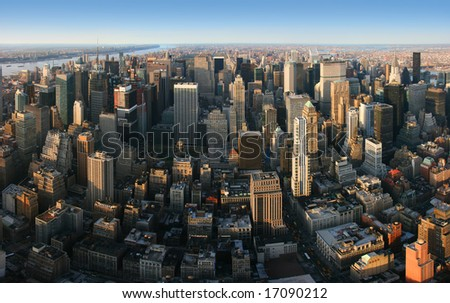 Aerial panoramic view over Manhattan from Empire State building top, New York. Sunset of a clear, sunny day.