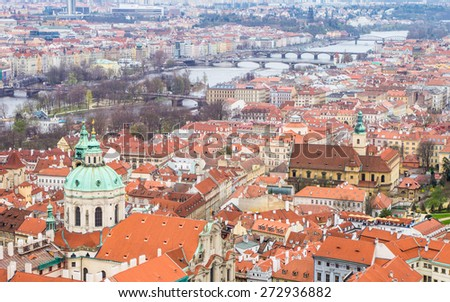 Aerial panoramic view to the old town and Vltava river with bridges over it - Prague, Czech republic - UNESCO world heritage site - stock photo