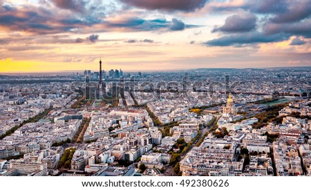 Aerial Paris view in late autumn from Montparnasse Tower at sunset. Eiffel Tower in the distance and financial district.