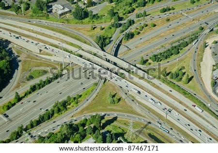 Aerial perspective of I-405 crossing over I-90 in Bellevue, WA - stock photo