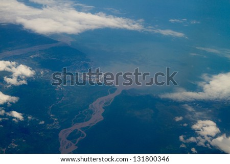 Aerial photo of river sediment flowing into the ocean nect to the town of Lae, aerial photo. Papua New Guinea - stock photo