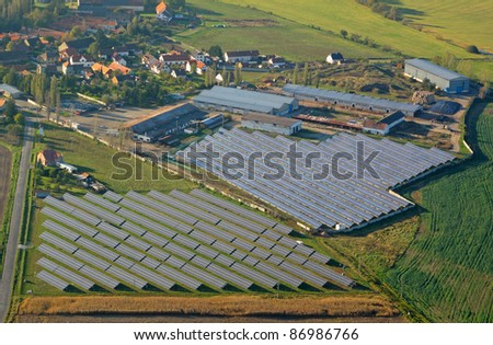 Aerial photo of solar power plant. Many solar energy panels in countryside from above. Photovoltaic power station near Pilsen, Czech republic, European union. - stock photo