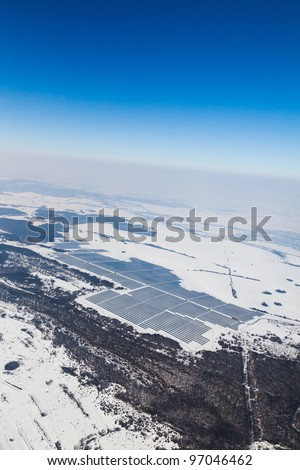 Aerial photo of solar power plant. Many solar energy panels in countryside from above. Photovoltaic power station near Samovodene, Bulgaria, European union. - stock photo