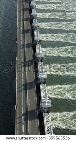 Aerial photo of the Oosterscheldekering, a storm surge barrier which is part of the delta works to protect Holland from high sea level - stock photo