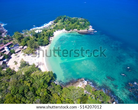 Aerial photo of tropical island with white sand beach on the cape and turquoise clear water. Thailand, Phuket, Paradise beach.