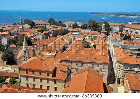 aerial photo view of ancient town Zadar in Croatia, sea in background