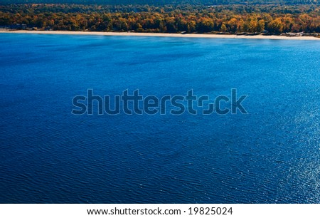 Aerial photograph taken during the autumn season just off from a beach in cottage country - stock photo