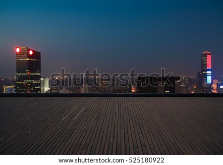 Aerial photography bird view at Empty wood floor with city landmark buildings background at Shanghai Skyline of night scene