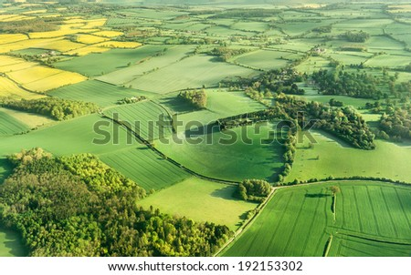 Aerial photography of green fields in English countryside - stock photo