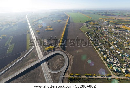 Aerial Road interchange, viaduct. Crossroads view, parks and parking lots, bridges. Copter shot. Panoramic image. - stock photo