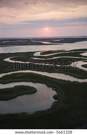 Aerial scenic Bald Head Island North Carolina landscape of marshland during sunrise. - stock photo