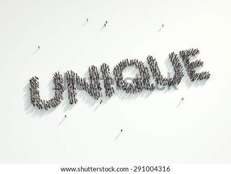 Aerial shot of a crowd of people gathered together to form the word 'Unique'. Concept for how every person is different in their personality and looks and yet we are all the same.