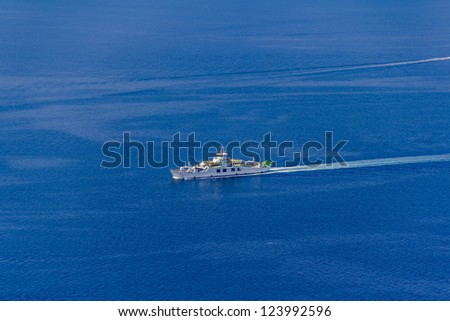 Aerial shot of ferry boat passing by on adriatic sea, Croatia - stock photo