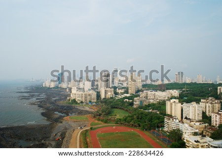 Aerial shot of Mumbai's afluent Napean Sea area with Arabian sea during day. Here most of super rich billionares and millionares stay in high-rise towers. Copy space. - stock photo
