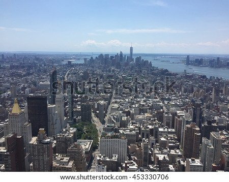 Aerial southern view of midtown and financial district of Manhattan New York City with Hudson River, view of New Jersey. Freedom Tower and Wall Street seen on southern tip of Manhattan in summer.