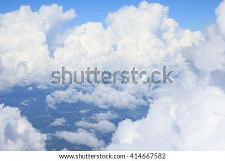 aerial top view from air plane flight high space with clear white cumulus cloud and cloudscape on blue sky - stock photo