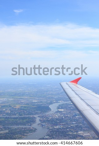 aerial top view from air plane see river city rural and wing aircraft engine with clear white cumulus cloud and cloudscape on blue sky - stock photo