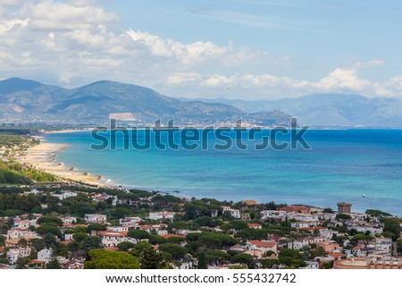 Aerial view above Sperlonga with white sand beach and blue sea, Lazio, Italy.