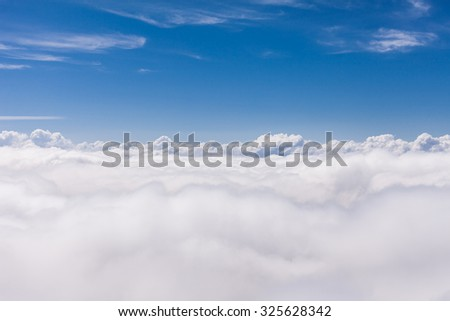 aerial view above the clouds - stock photo