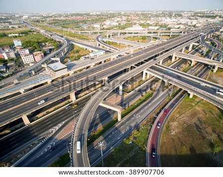 Aerial view above the inter-city expressway and ring road systems on the outer edge of Bangkok Metropolitan.