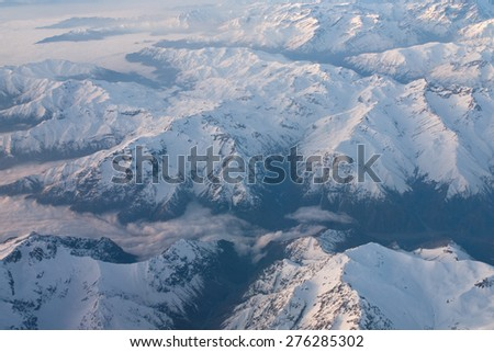 aerial view - andes mountains, sky and white clouds - stock photo