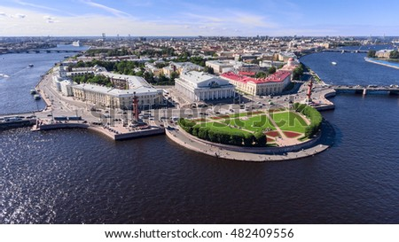 Aerial view at the Palace Bridge and buildings of Kunstkamera and old Saint Petersburg Stock Exchange on the spit of Vasilyevsky island. The Neva river, St. Petersburg, Russia