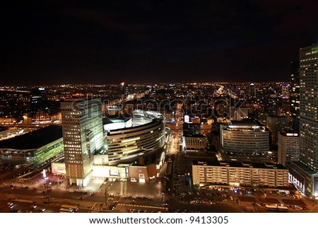 Aerial view at Warsaw downtown by night, from the top of Palace of Culture and Science - stock photo