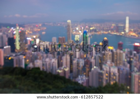 Aerial view blurred bokeh light Hong Kong city downtown over Victoria bay, abstract background