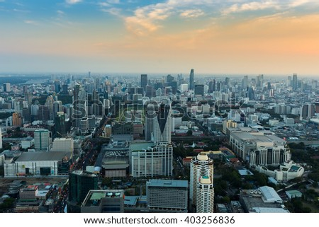 Aerial view city business district with blue sky background - stock photo