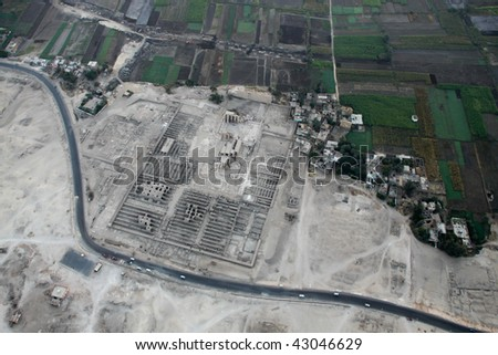 Aerial view form hot air balloon desert sand and green field Luxor Egypt - stock photo