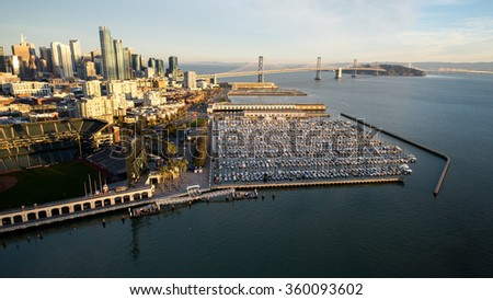 Aerial view from above McCovey Cove in the San Francisco Bay shows the South Beach Marina, the SOMA district, the San Francisco-Oakland Bay Bridge, and the rising skyline of Rincon Hill - stock photo