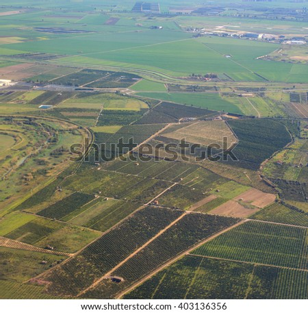 Aerial view from airplane over farm field in Italy