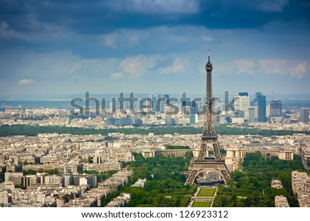 Aerial view from Montparnasse tower, looking over the Eiffel tower and La Defense district, Paris, France - stock photo
