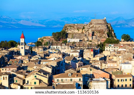 Aerial view from New fortress on the city with St. Spyridon church before sunset, Kerkyra, Corfu island, Greece - stock photo