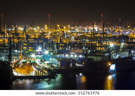 Aerial View from the Tower of the St. Michaelis Church over the Elbe River and the Port of Hamburg at night - stock photo