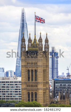 Aerial View from Westminster Cathedral on Roofs and Houses of London. Victoria Tower (Palace of Westminster) in the background. United Kingdom - stock photo