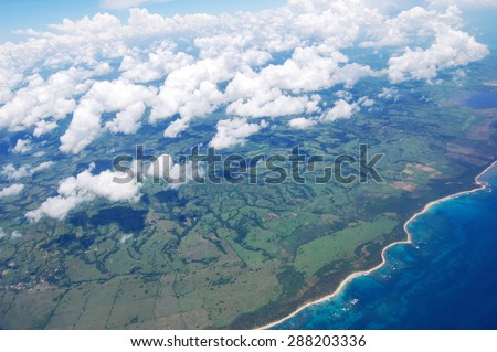 Aerial view gorgeous clouds above  Dominican Republic. Air transportation, travel, vacation, tropical and summer concept.  - stock photo