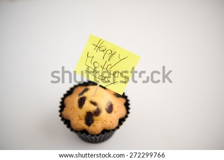 Aerial View Happy Mother's Day with cupcake and text message  Appreciation yellow sticky note greeting card with butter pastry cake with raisins, white natural light background - stock photo