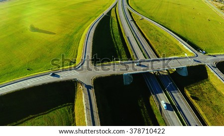 Aerial view. Highway. Green fields landscape.